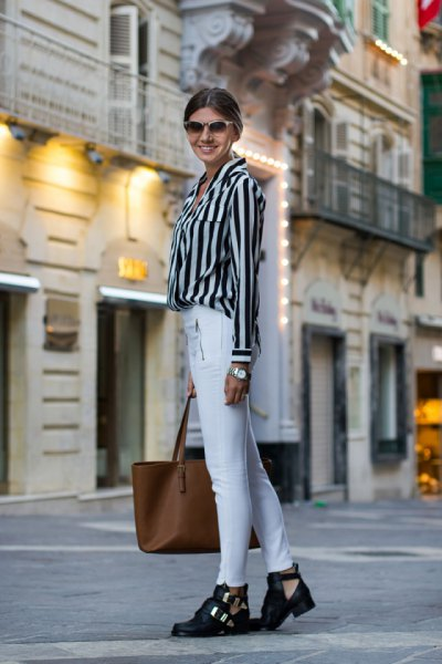 black and light gray striped shirt with buttons and white skinny jeans