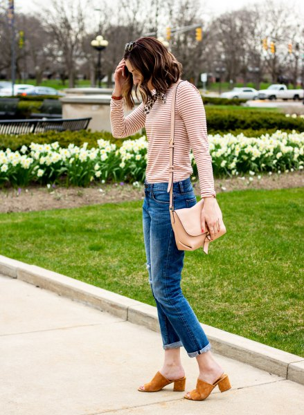 black and light pink striped long-sleeved T-shirt with blue-cut slim fit jeans