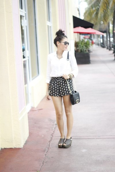 black and pink patterned mini shorts with white shirt with buttons