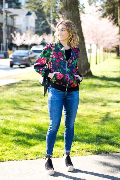 black and red floral bomber jacket with blue jeans