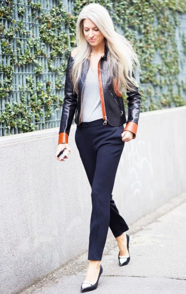 black and red leather jacket with dark blue pants