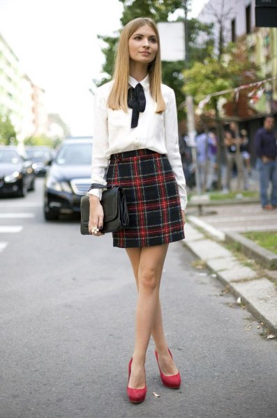 black and red plaid skirt with white fly shirt