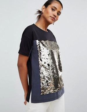 black and silver sparkling color block t-shirt with white jeans