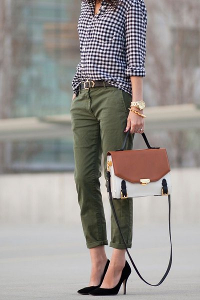 black and white checked shirt with buttons and straight leg trousers with green cuffs