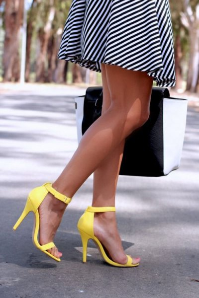 black and white diagonally striped mini fit and flare dress with yellow high heels with open toes