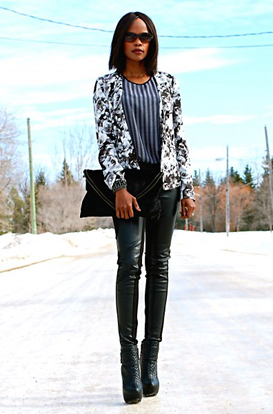 Black and white blazer with a floral pattern and a vertically striped blouse
