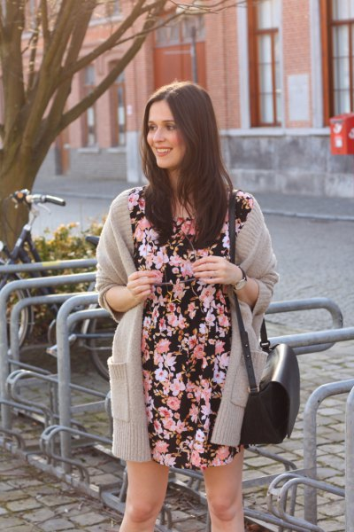 Black and white mini dress with floral pattern and gray long cardigan