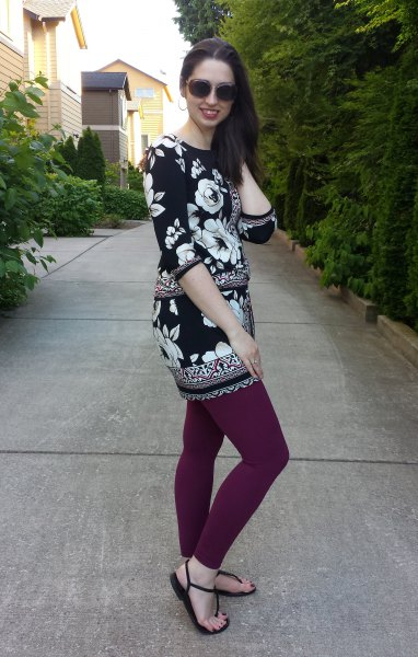 Tunic top with floral pattern in black and white with gray leggings