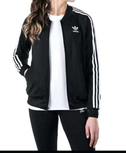 Black and white jacket with t-shirt and running shorts