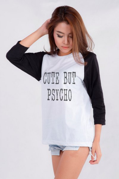 graphic black and white long-sleeved T-shirt with light blue denim shorts