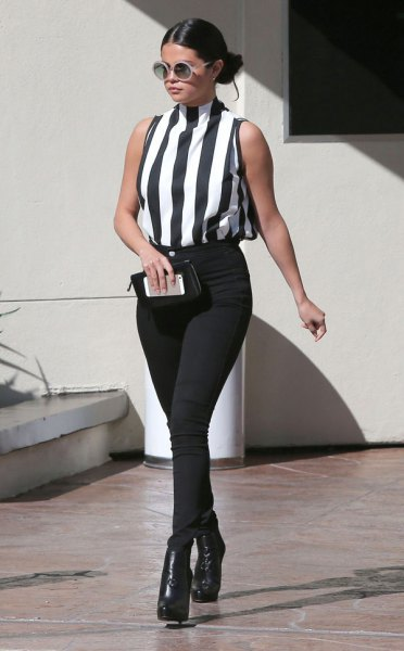vertically striped top with black and white stand-up collar and skinny jeans