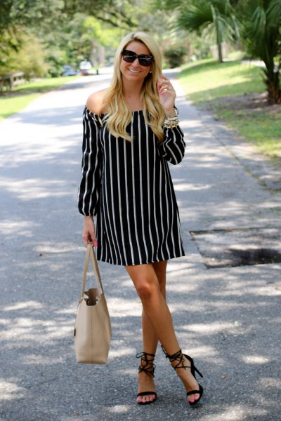 strapless black and white mini dress with pink wallet