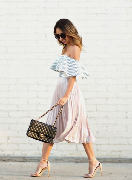 Off-the-shoulder frilled top in black and white with a pleated midi skirt