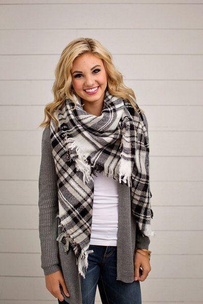 black and white checkered blanket scarf with a gray, torn cardigan