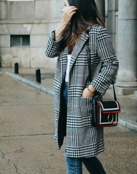Black and white checked coat with a white top and blue jeans