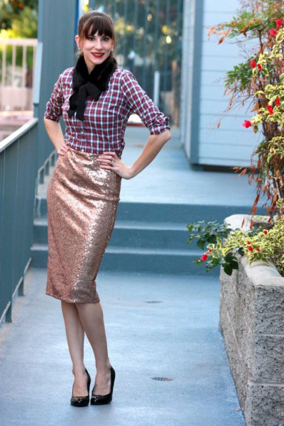 black and white checked shirt with rose gold colored skirt