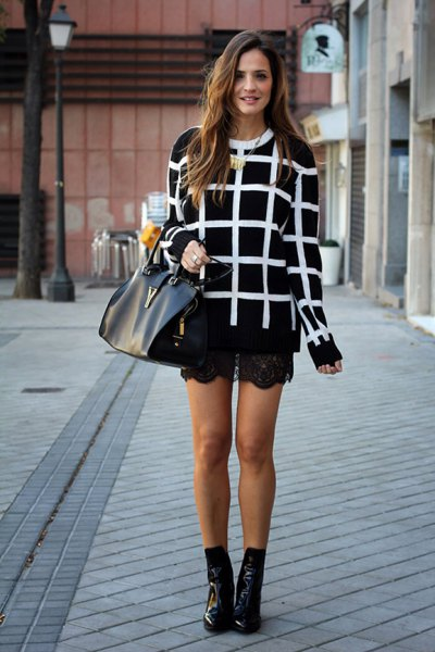 black and white checkered sweater with lace shorts and short leather boots