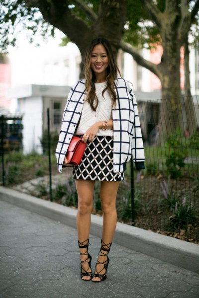 black and white checked wool coat with high-heeled black lace-up sandals