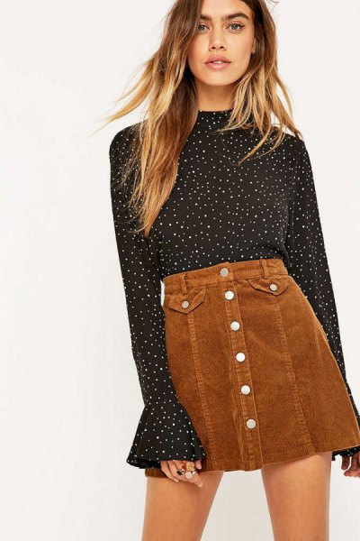 black and white dotted bell sleeve blouse with a brown mini skirt