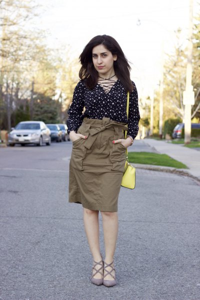 Black and white polka dot blouse with a green cargo high skirt