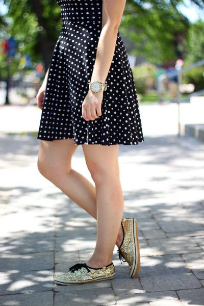 black and white polka dot and flared mini dress with gold sequin sneakers