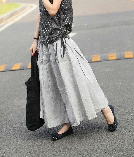 black and white polka dot sleeveless blouse with light gray maxi linen skirt
