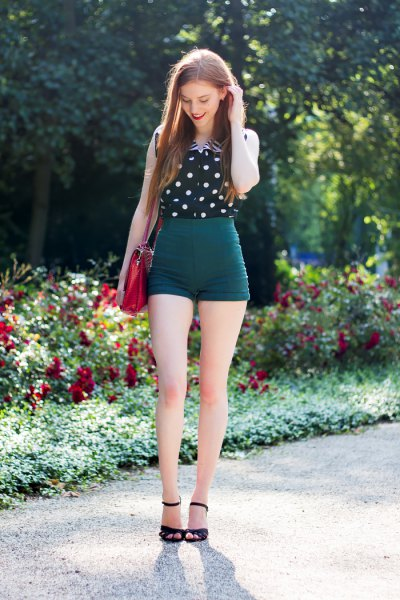 sleeveless shirt with black and white polka dots and high-waisted vintage shorts