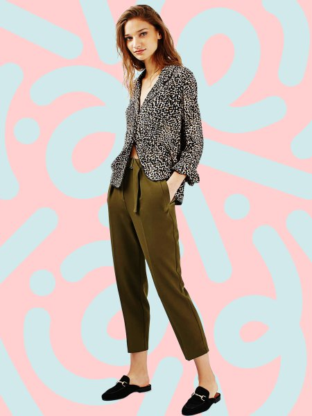 black and white printed blazer with green trousers