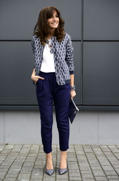 black and white printed blazer with white blouse and shortened navy trousers