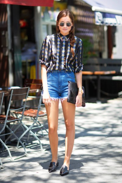 black and white printed shirt with buttons and light blue denim shorts