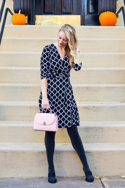 Knee-length wrap dress in black and white