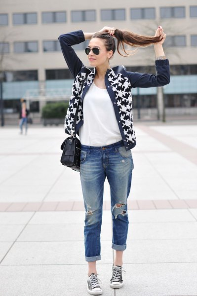 black and white printed leather jacket with really ripped jeans