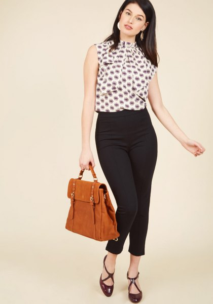 sleeveless blouse with black and white print and ponte trousers
