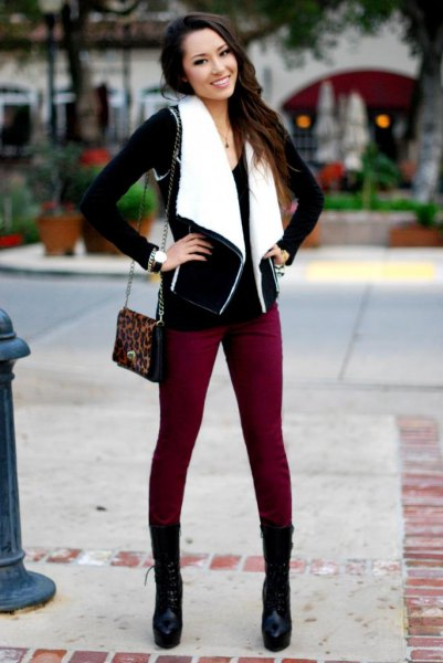 black and white lambskin vest with brown skinny jeans and boots in the middle of the calf