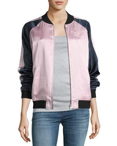 black and white silk bomber jacket with gray t-shirt and blue jeans