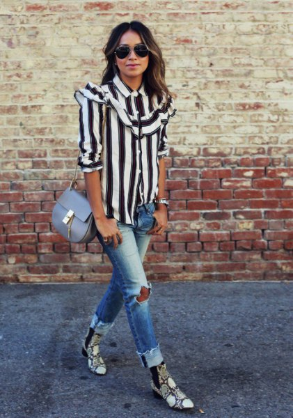black and white striped shirt with buttons and ripped jeans