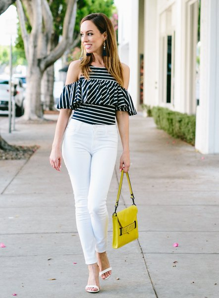 black and white striped cold shoulder ruffles top with yellow leather handbag