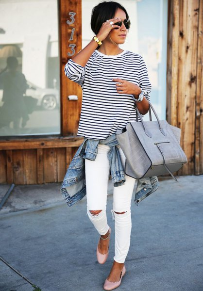 black and white striped long-sleeved t-shirt with round neck and torn slim fit jeans
