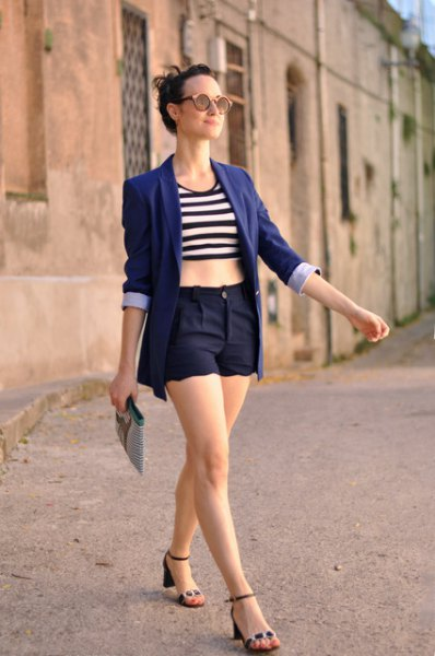 black and white striped crop top with dark blue blazer and matching shorts with scalloped hem