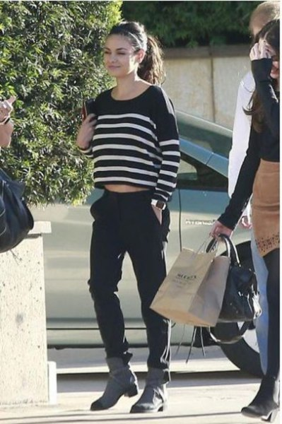 black and white striped shortened sweater with gray boots