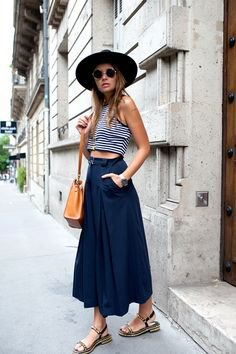 black and white striped, short tank top with dark blue maxi skirt