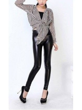 black and white striped knotted blouse with leather gaiters and high heels