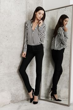 black and white striped long-sleeved blouse with chinos