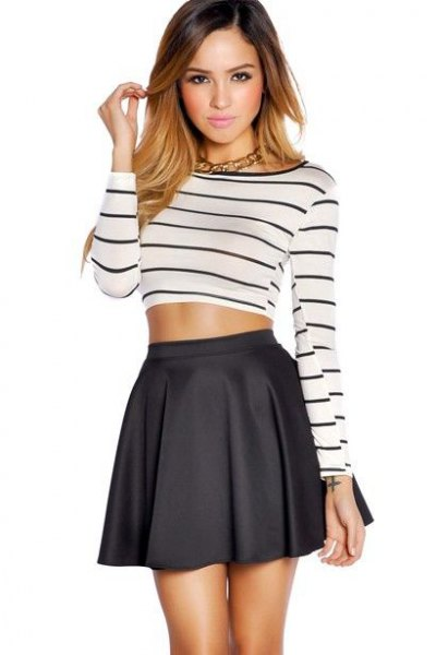 black and white striped long-sleeved short t-shirt with a high-waisted minirater skirt