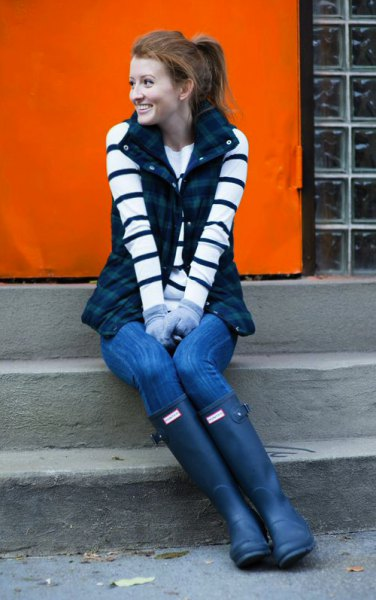 black-and-white striped long-sleeved sweater with dark blue checked vest