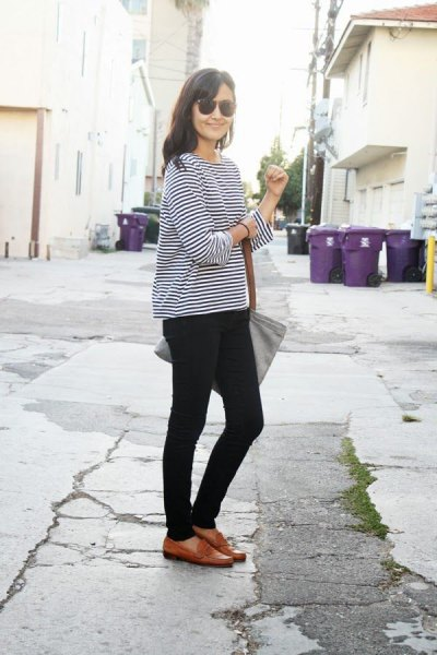 black and white striped long sleeve T-shirt with brown slippers