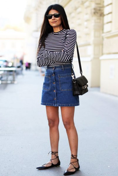 black and white striped long-sleeved T-shirt with blue denim button on the front of the skirt