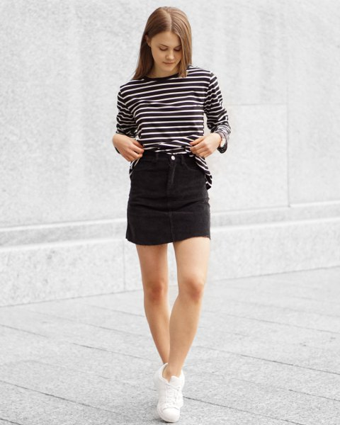 black and white striped long-sleeved T-shirt with a high corduroy skirt