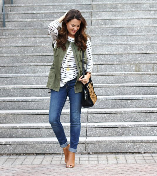 black and white striped long-sleeved T-shirt with a military vest and skinny jeans