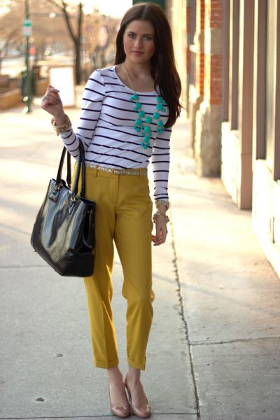 black and white striped long-sleeved T-shirt with mustard-cut trousers